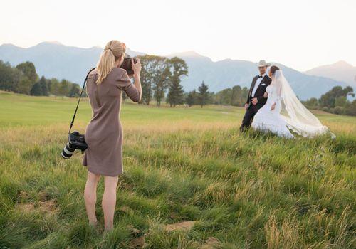 photographer photographs wedding