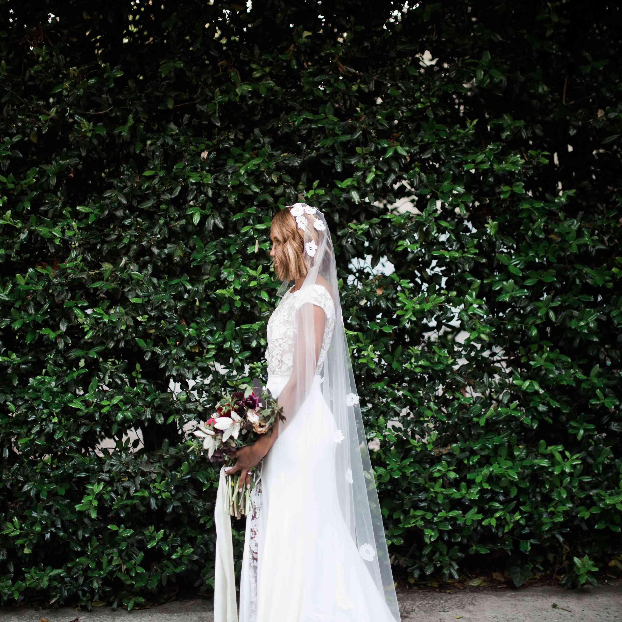 Bride outdoors holding bouquet