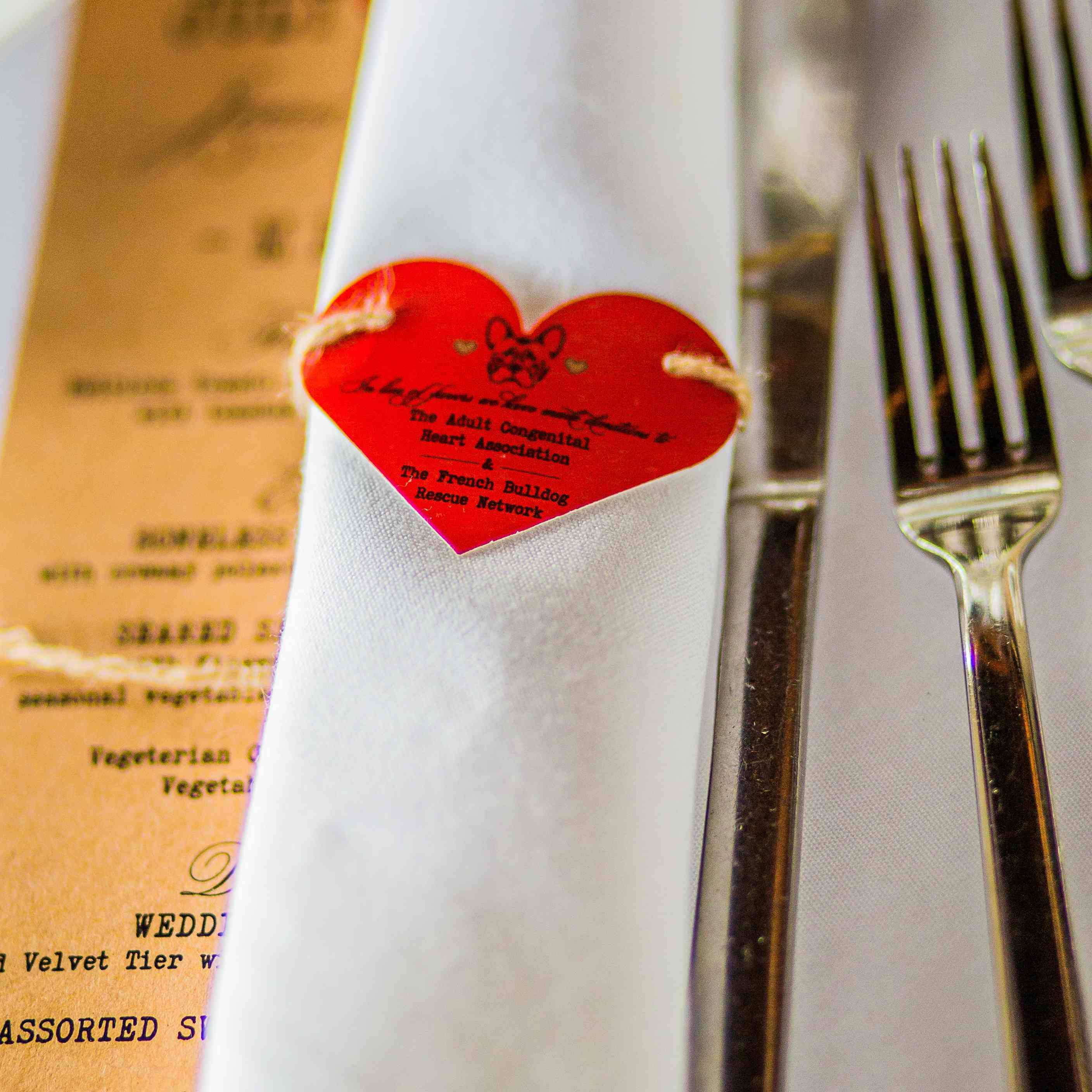 Charity information on a heart-shaped napkin holder