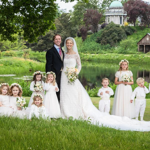 Lady Gabriella Windsor and Thomas Kingston in wedding attire beside eight children in white