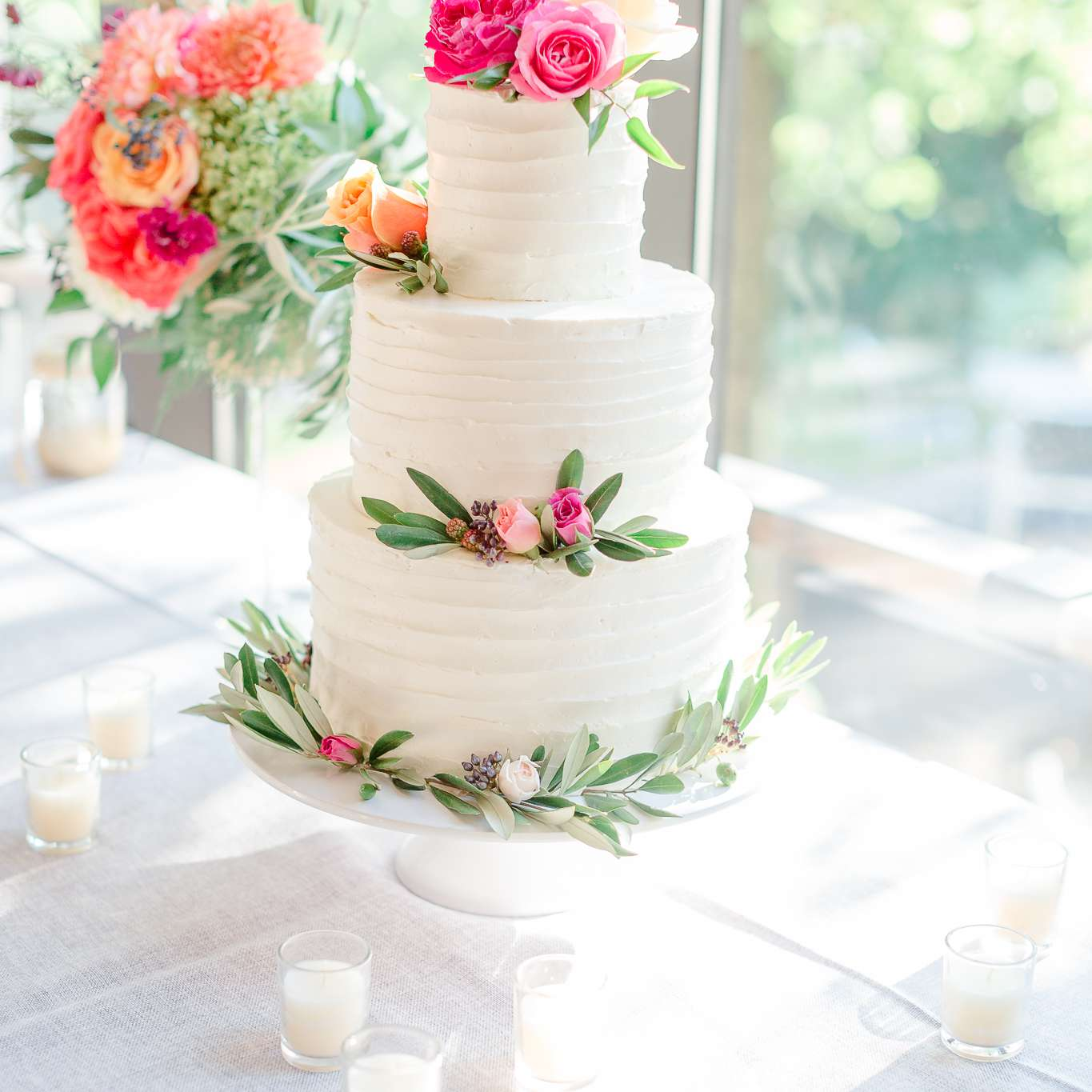 Three-Tiered White Wedding Cake with Pink Roses