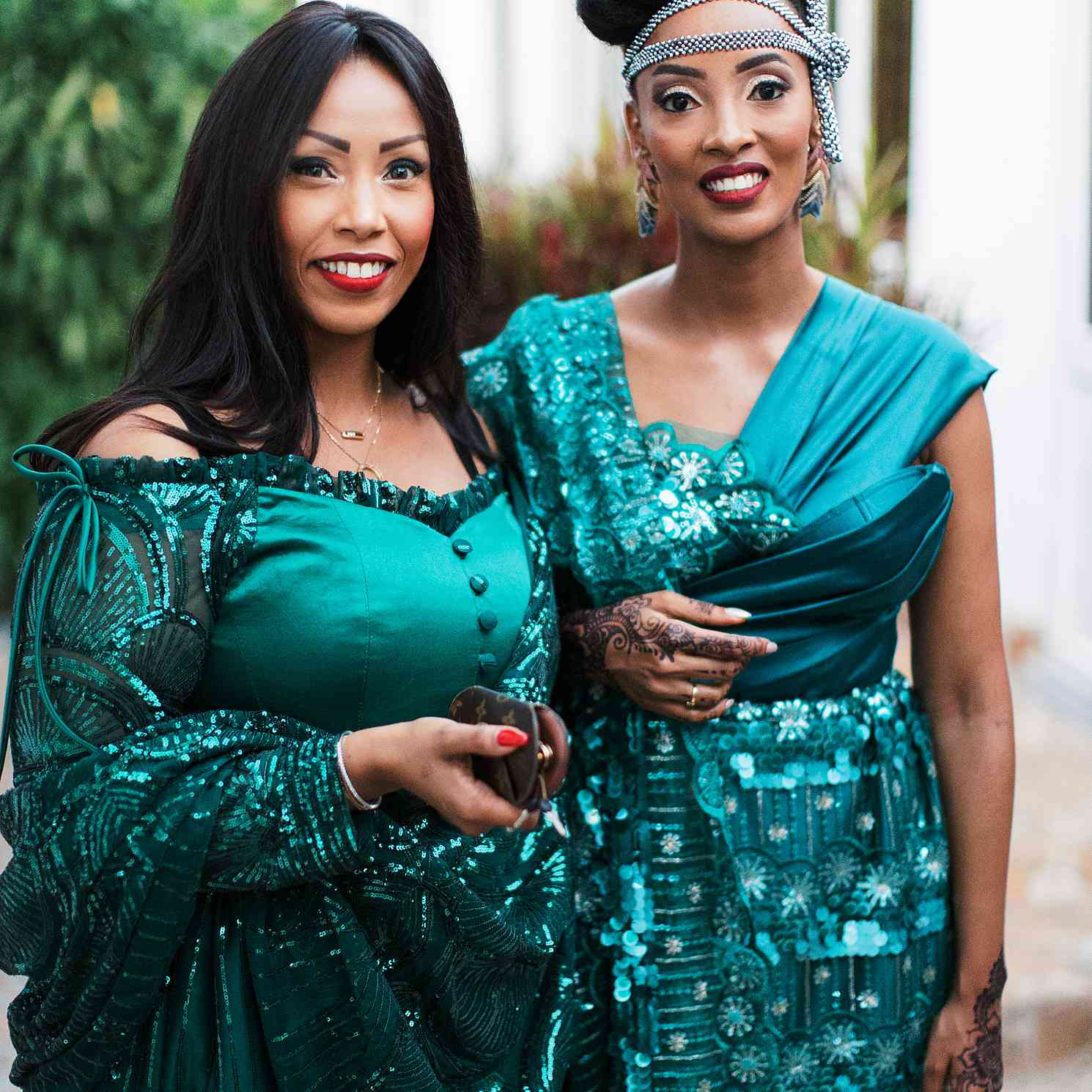 two women posing for a photo at a wedding