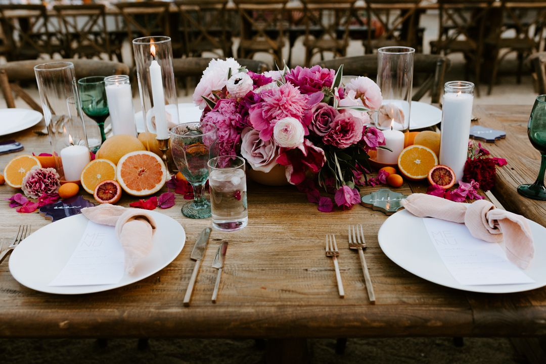 Centerpiece arrangement of flowers and citrus fruit