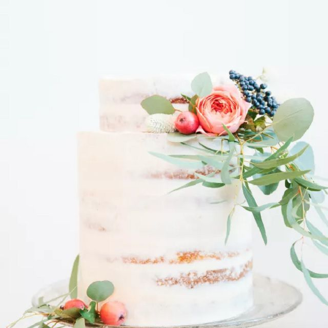 Naked cake with tall bottom tier and florals