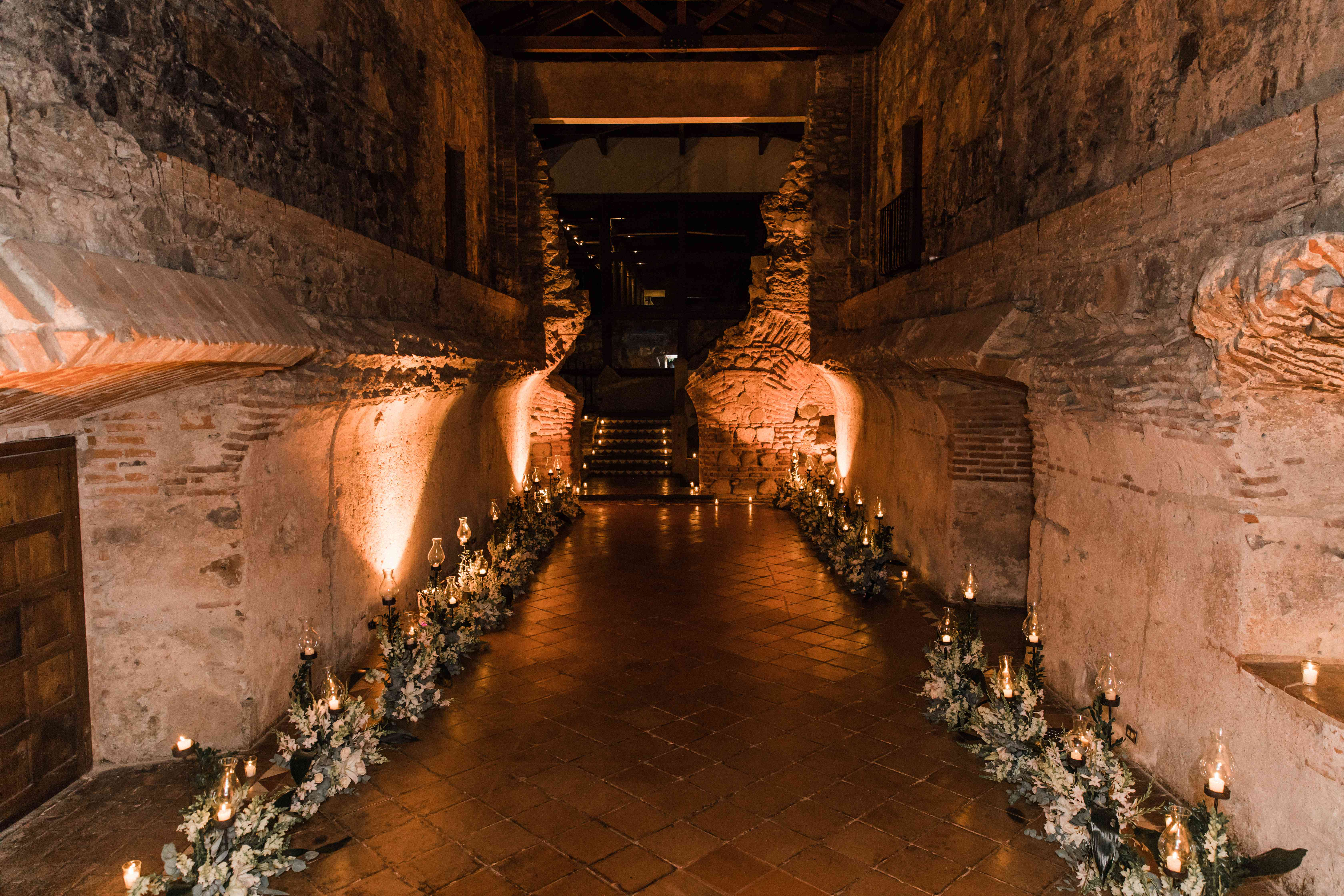 <p>candle and and flower lined reception entrance</p><br><br>