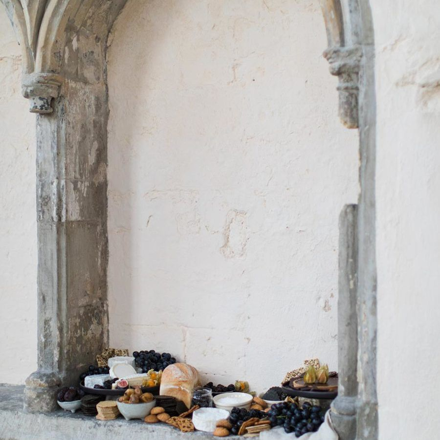 Small grazing table set up in an archway
