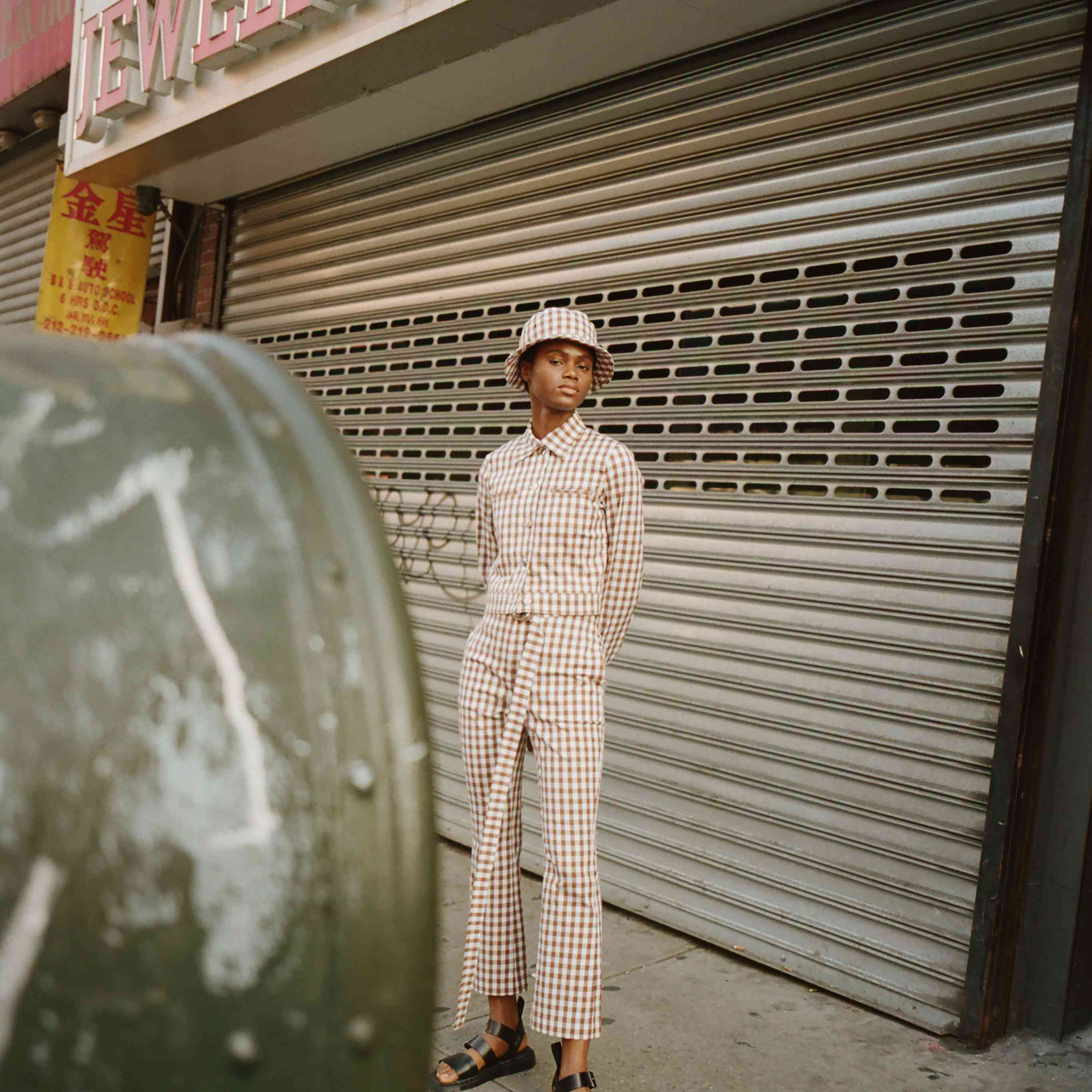 Model in gingham cropped jacket and pants