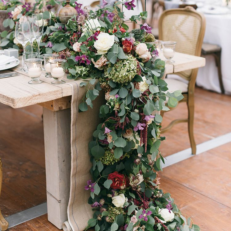 Greenery runner with purple and red florals