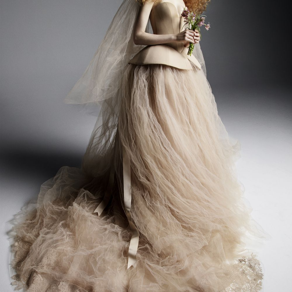 Model in strapless nude gown with a voluminous tulle skirt with a lace trim