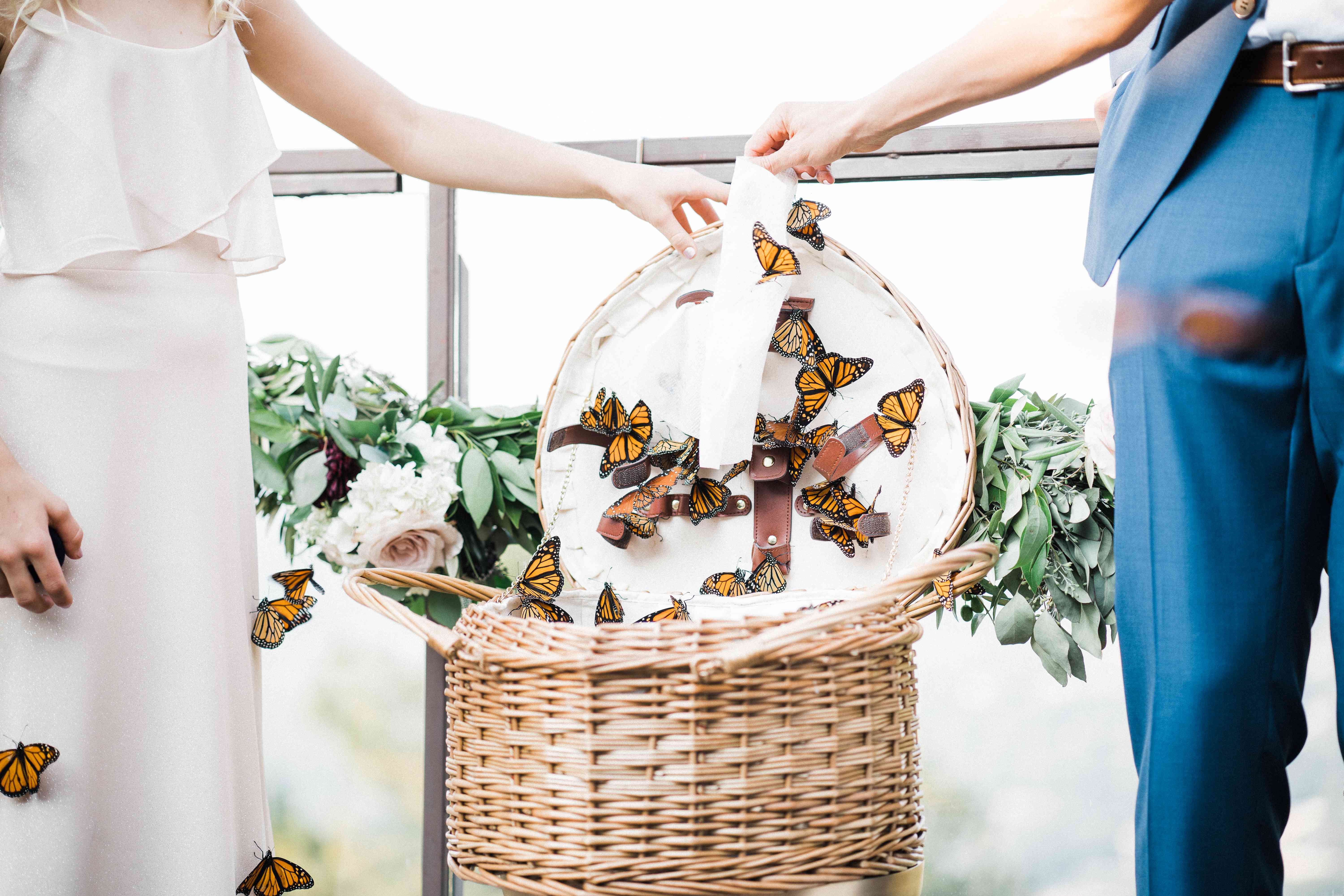 <p>Bride and groom with butterfly basket</p><br><br>