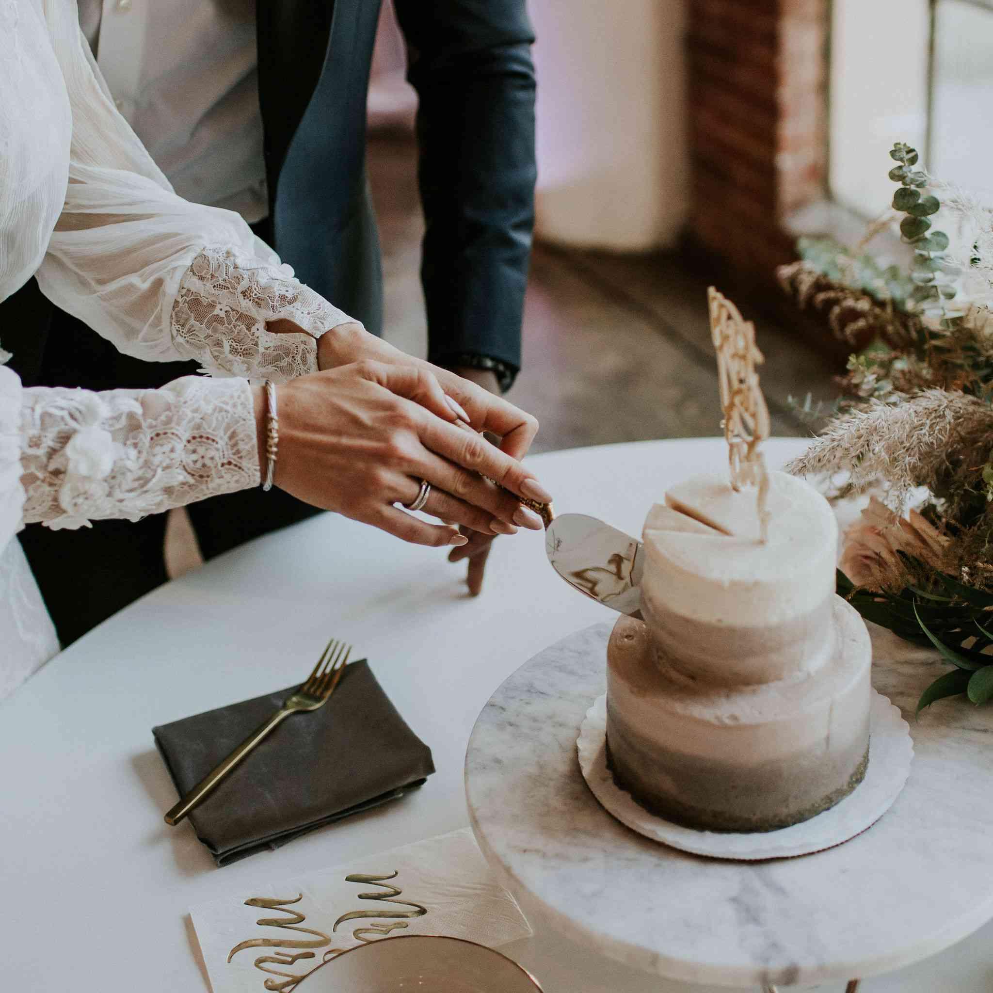 bride cutting cake