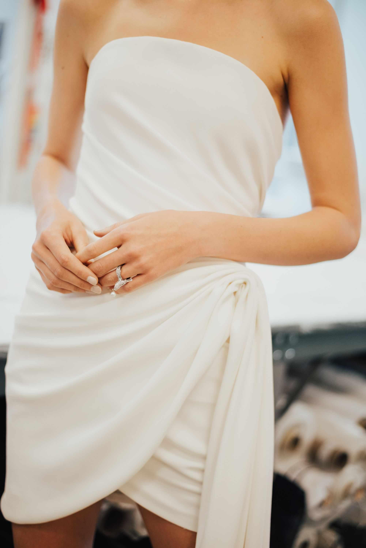Short bridal dress and nude nails