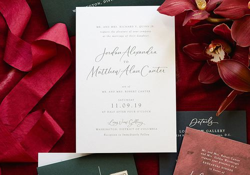 Invitation suite with red backdrop
