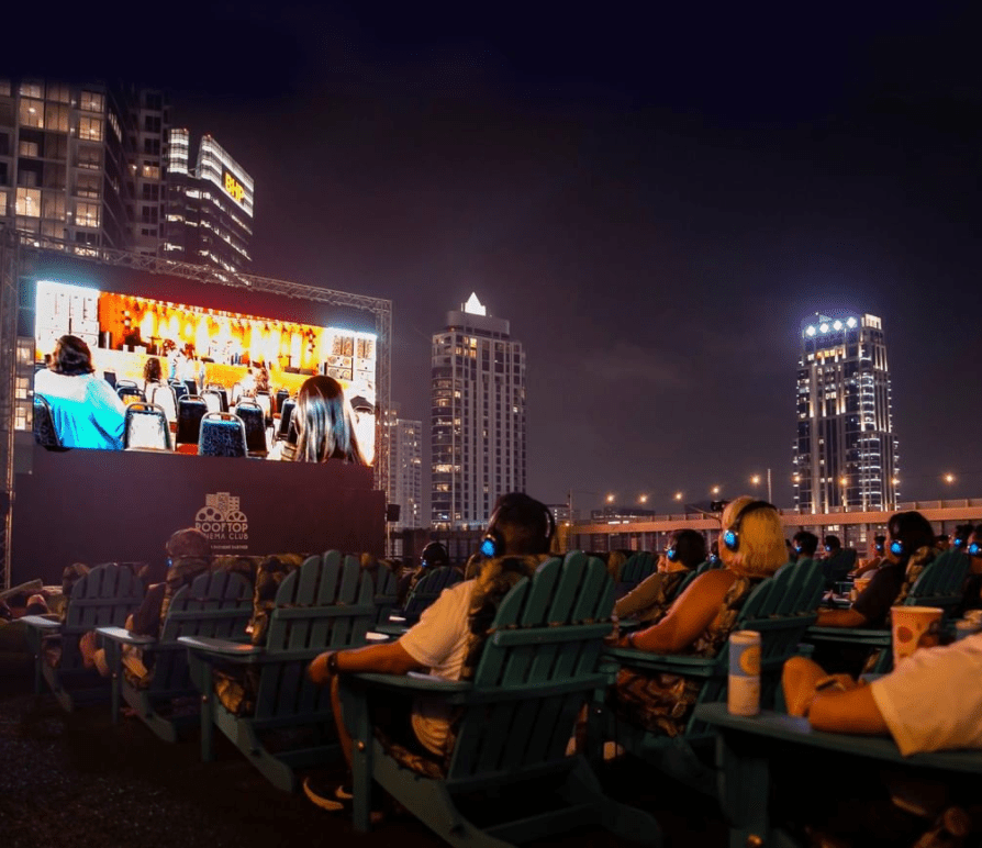 People watching a movie on a rooftop in Houston