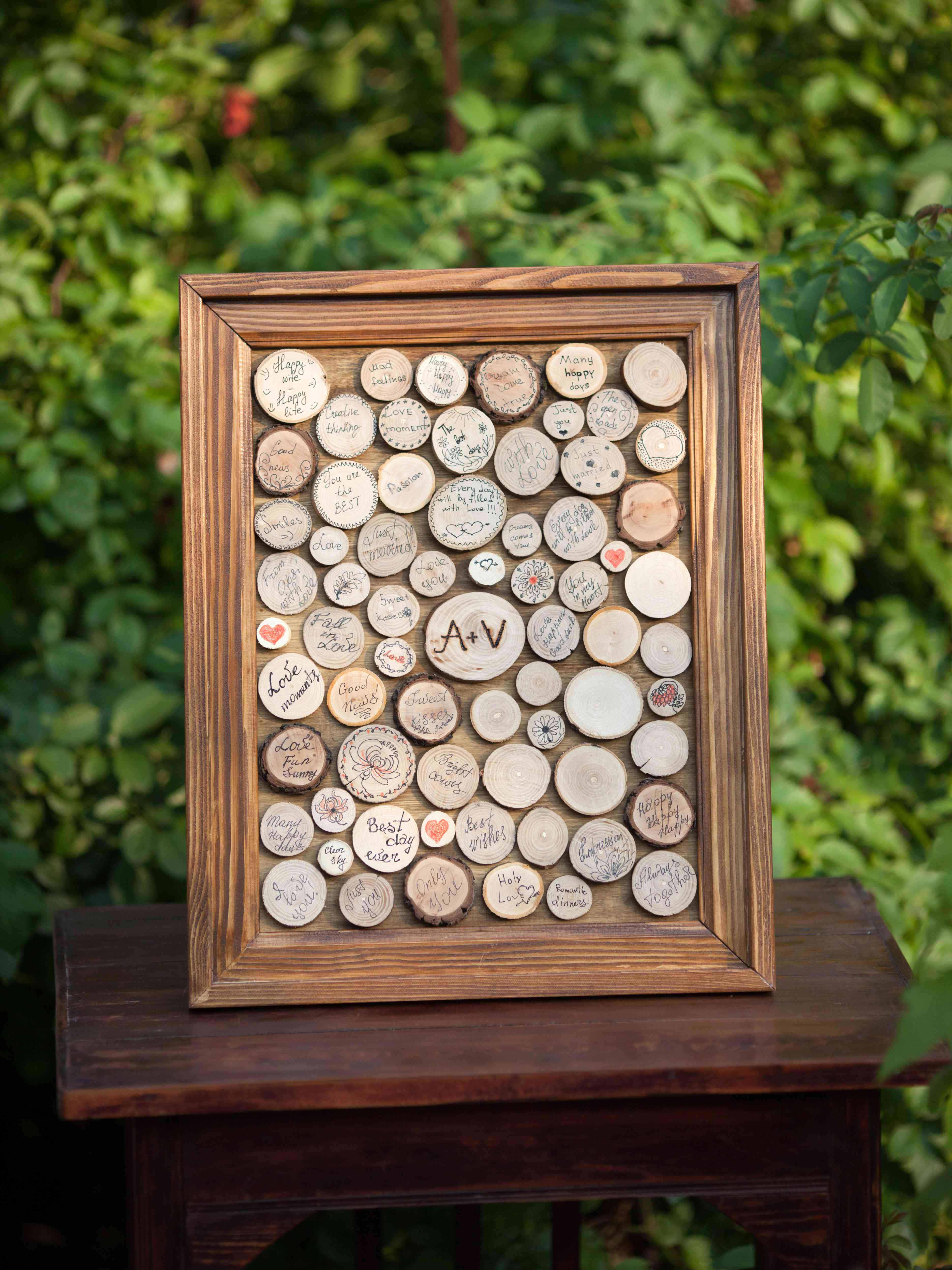 Wooden frame with signed pieces of wood