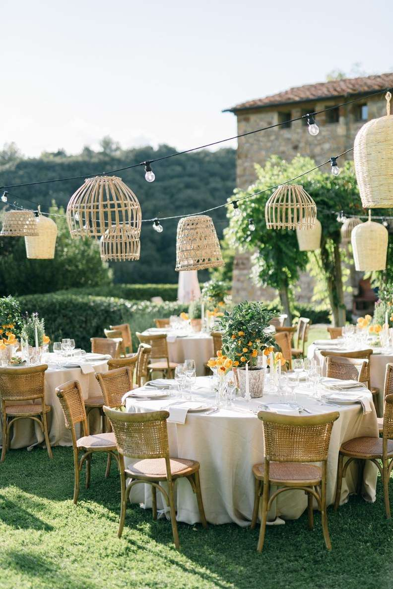 Outdoor wedding reception tables with hanging basket lanterns