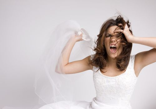 Angry bride ripping off veil