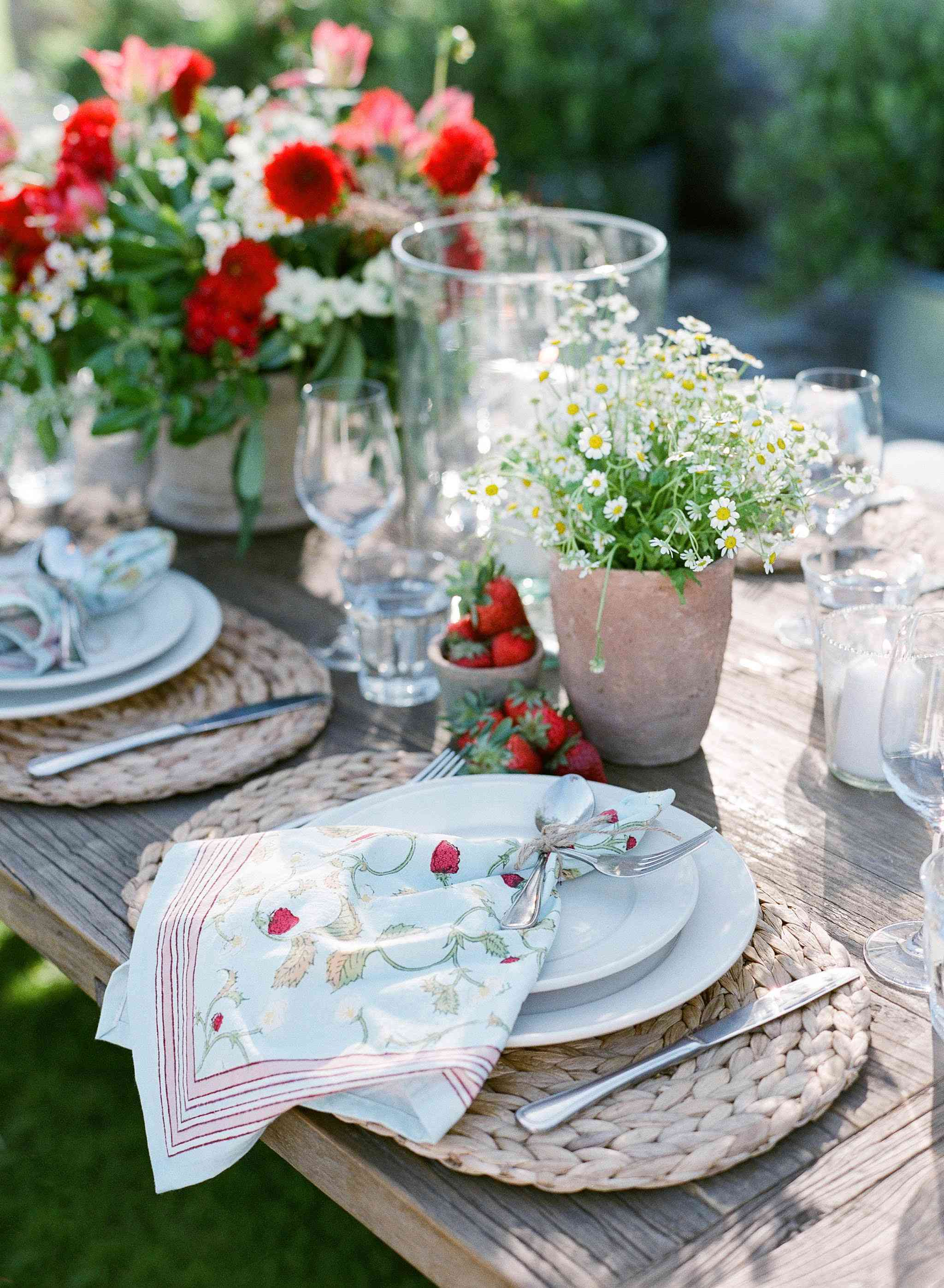Table setting outdoors with fresh strawberries