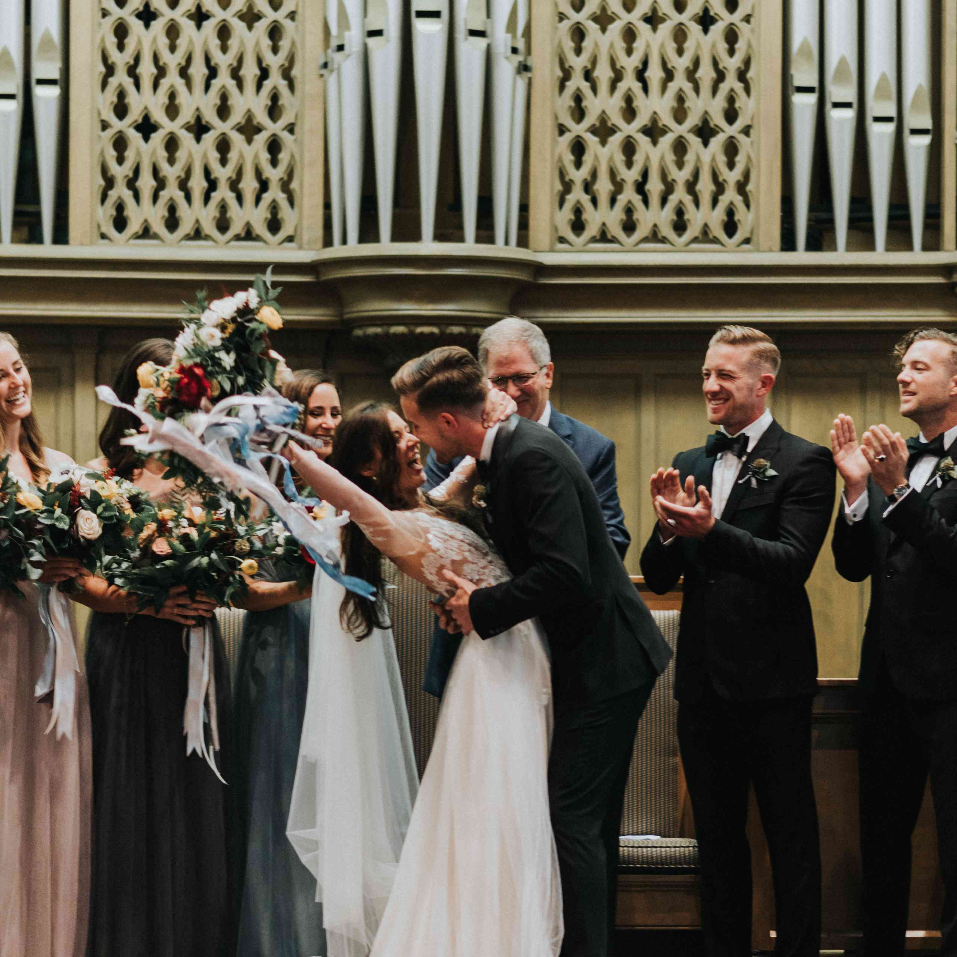 personalized michigan wedding, bride and groom first kiss