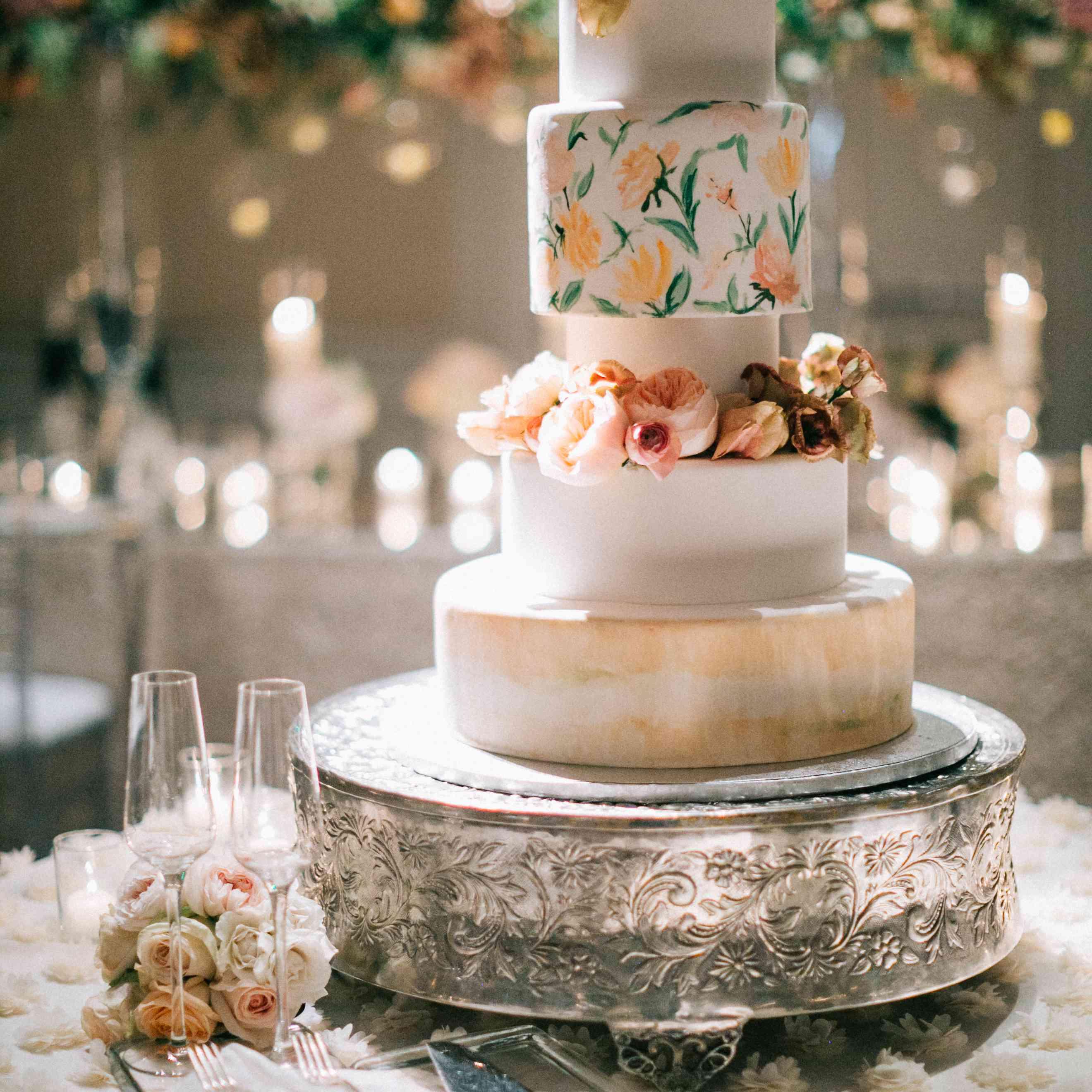 A five-tier watercolor wedding cake
