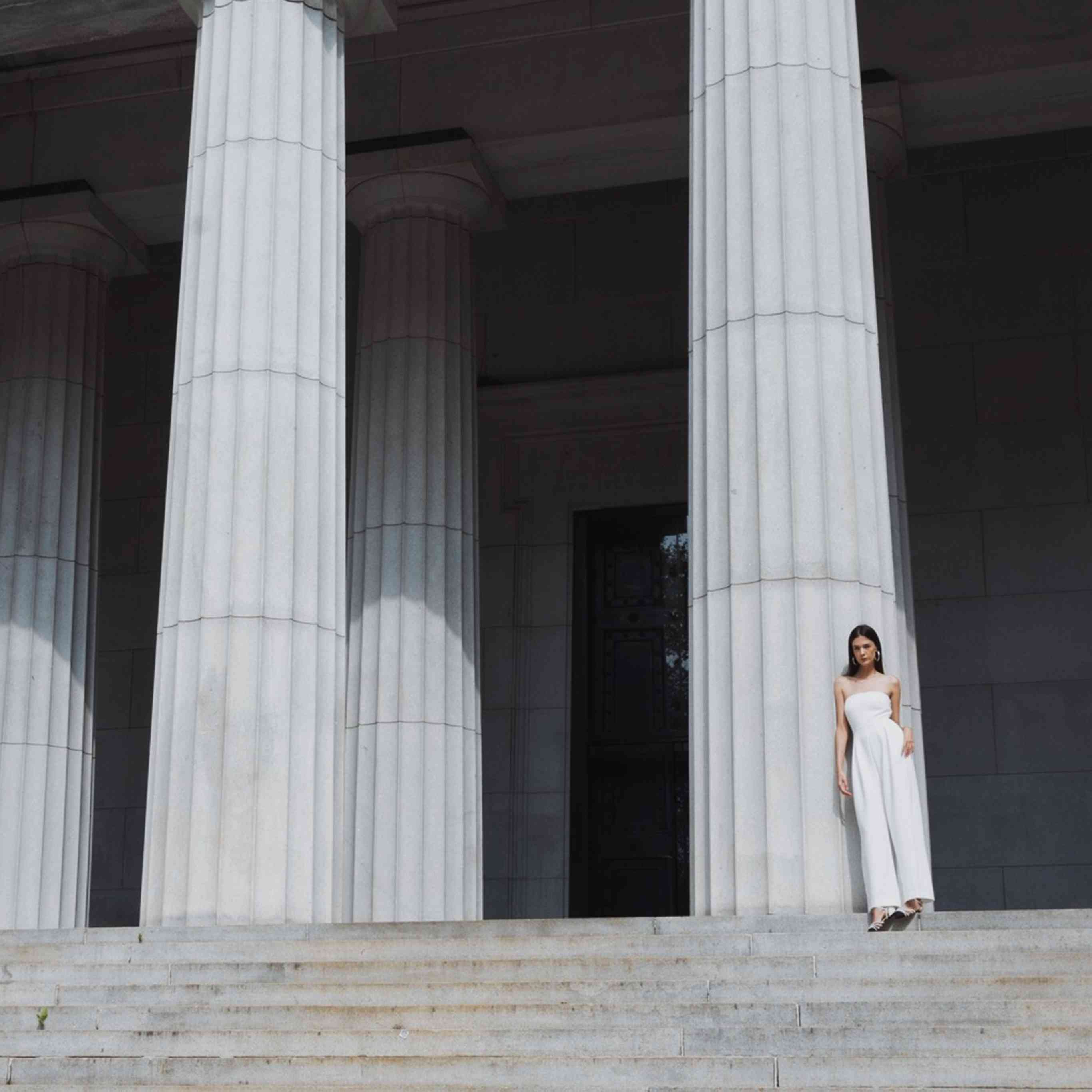 Model in strapless wedding jumpsuit with wide leg pants