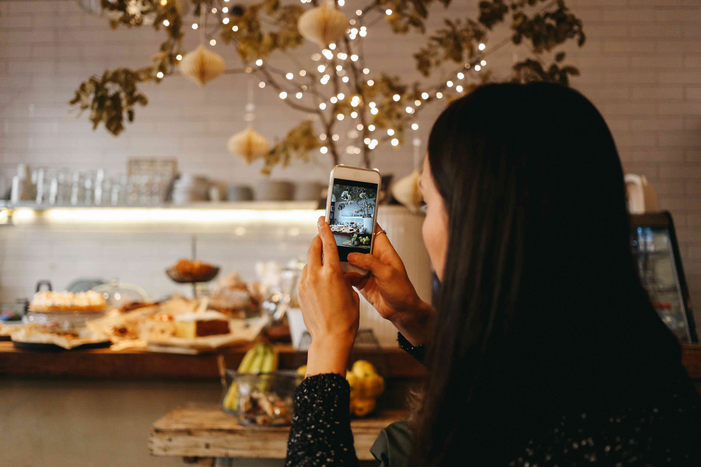 Taking photo on iPhone of bakery