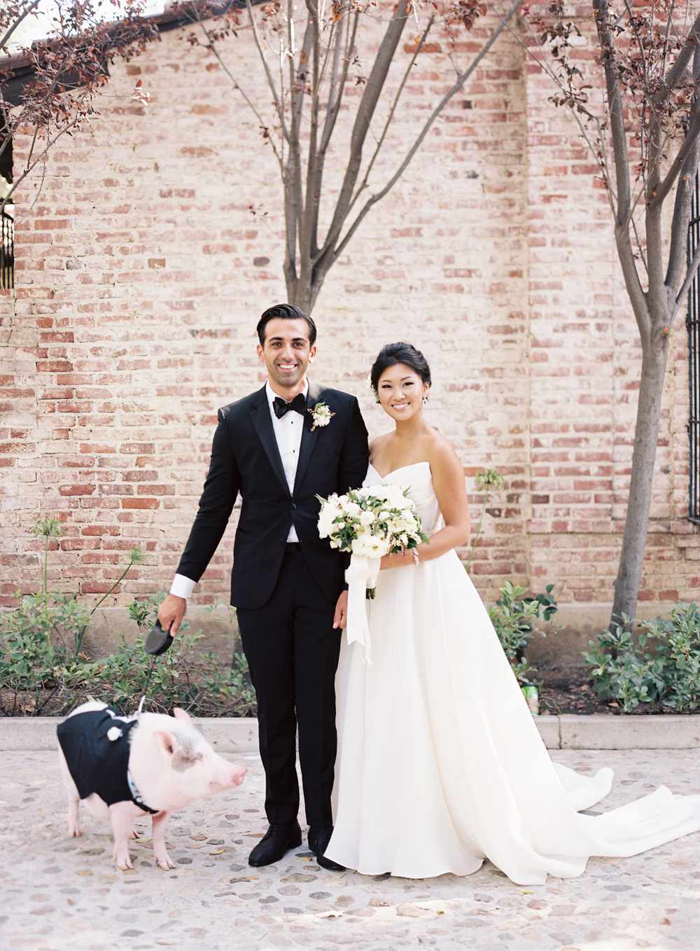 Newlyweds with pig