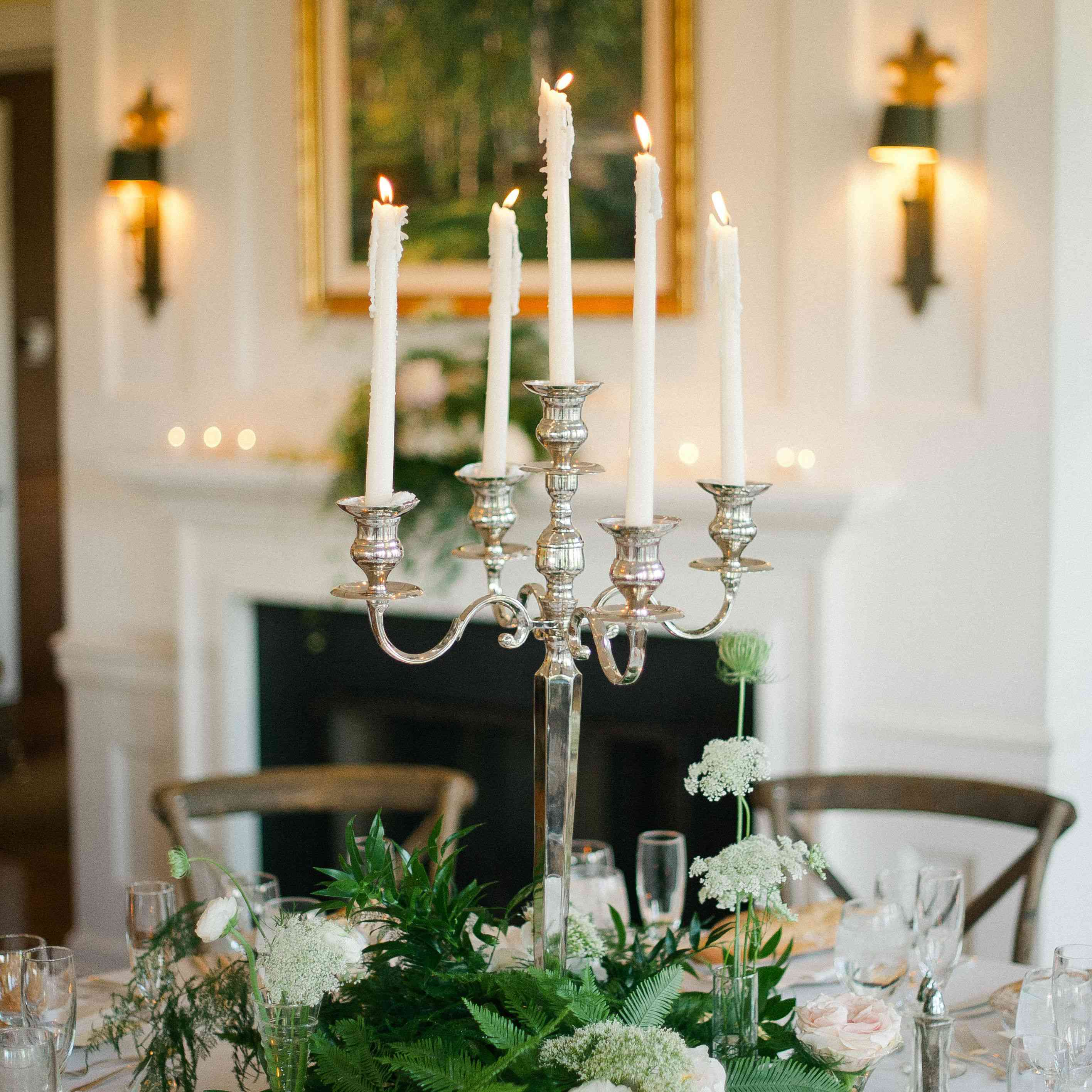 Silver candle on wedding reception table