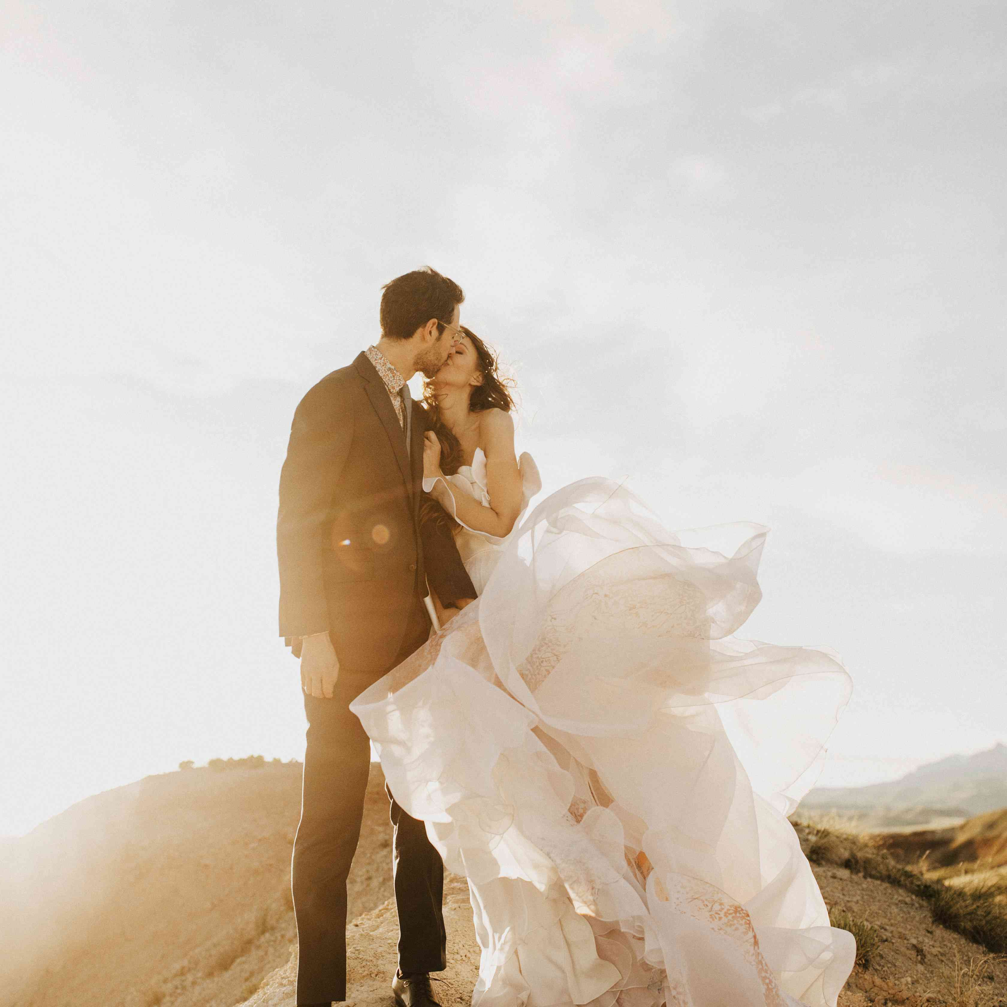 Bride and groom kissing on Mountain top