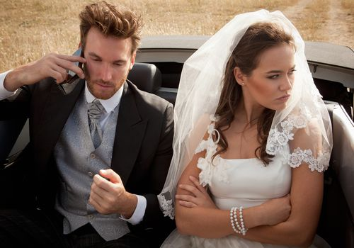 Groom on phone with angry bride