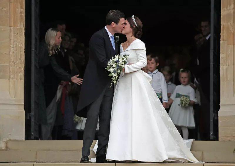 Princess Eugenie and Jack Brooksbank kissing at wedding
