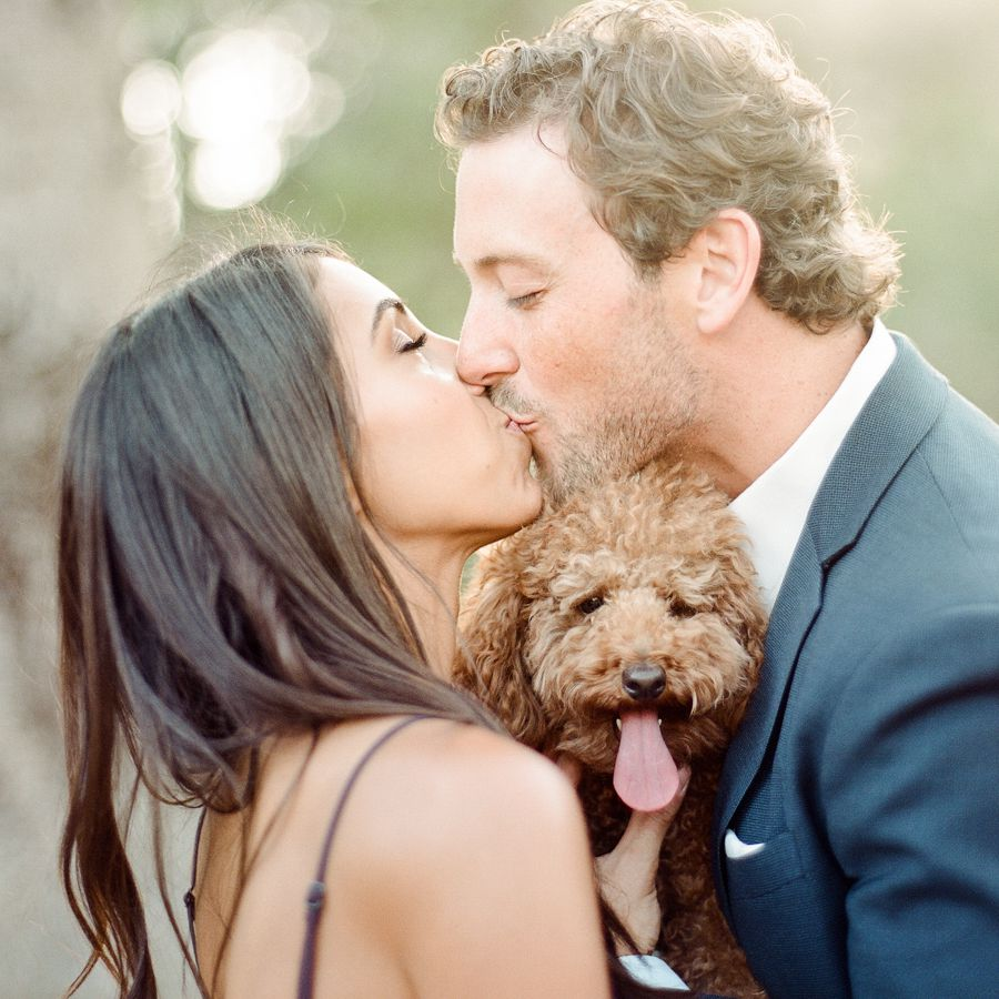 Couple kissing with dog