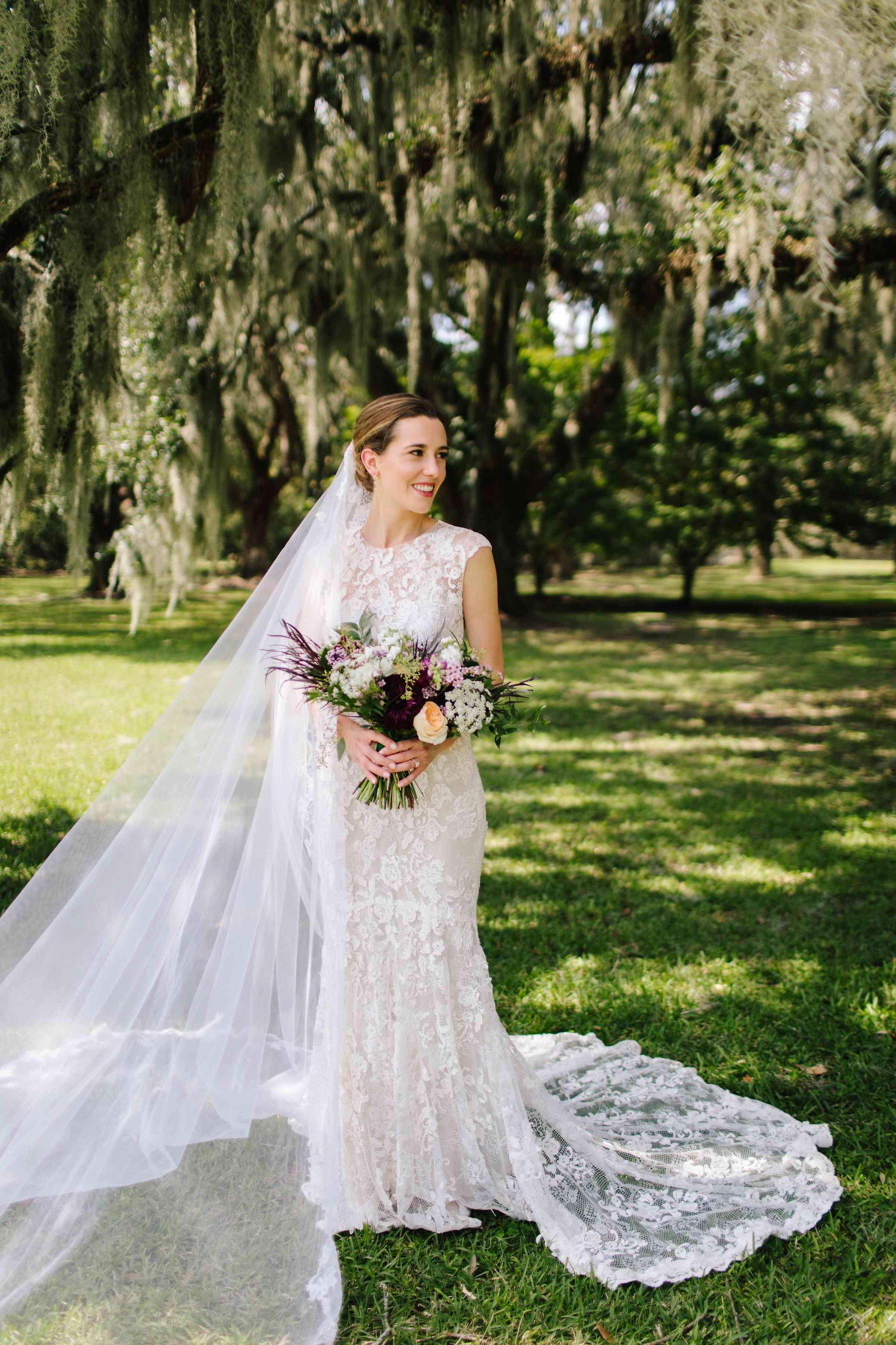 <p>Bride solo holding bouquet</p><br><br>