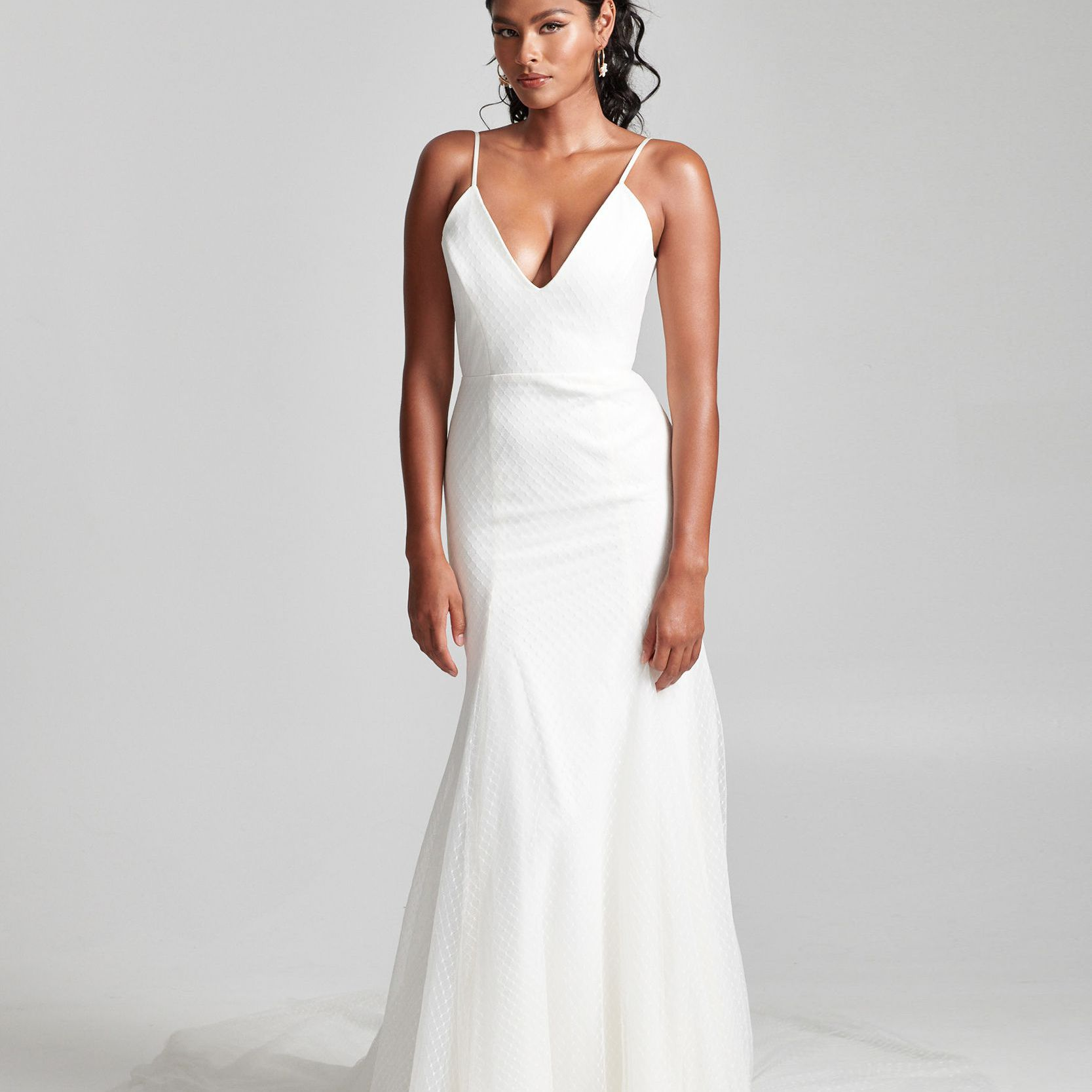 Model in spaghetti strap v-neck wedding dress with tulle
