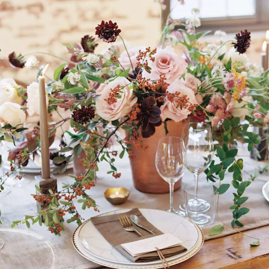 Blush hued centerpiece with berries