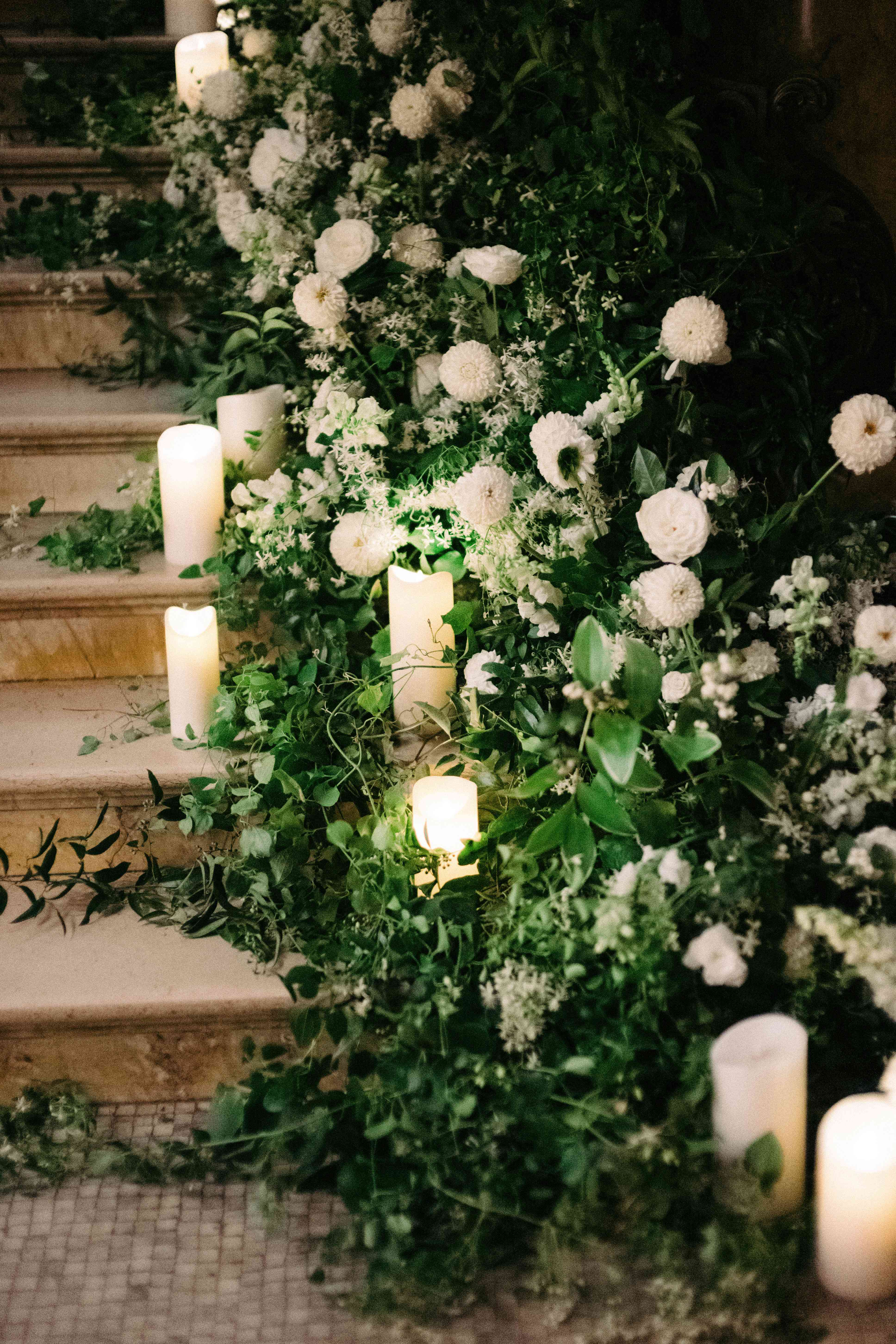 floral and greenery decor with candles