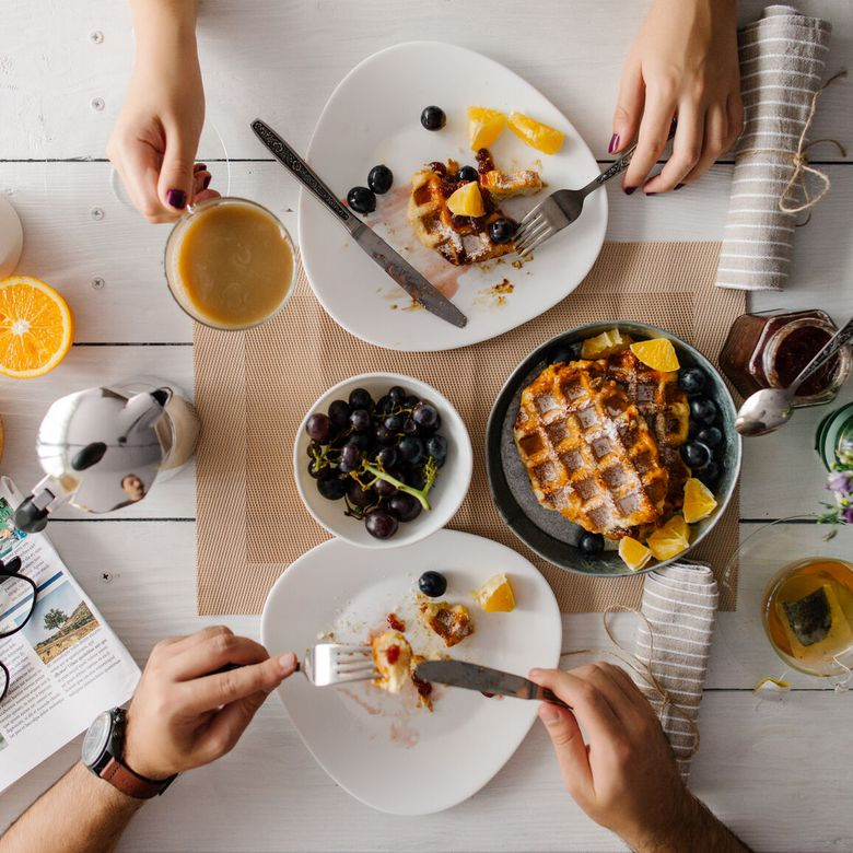 couple at brunch with waffles and coffee