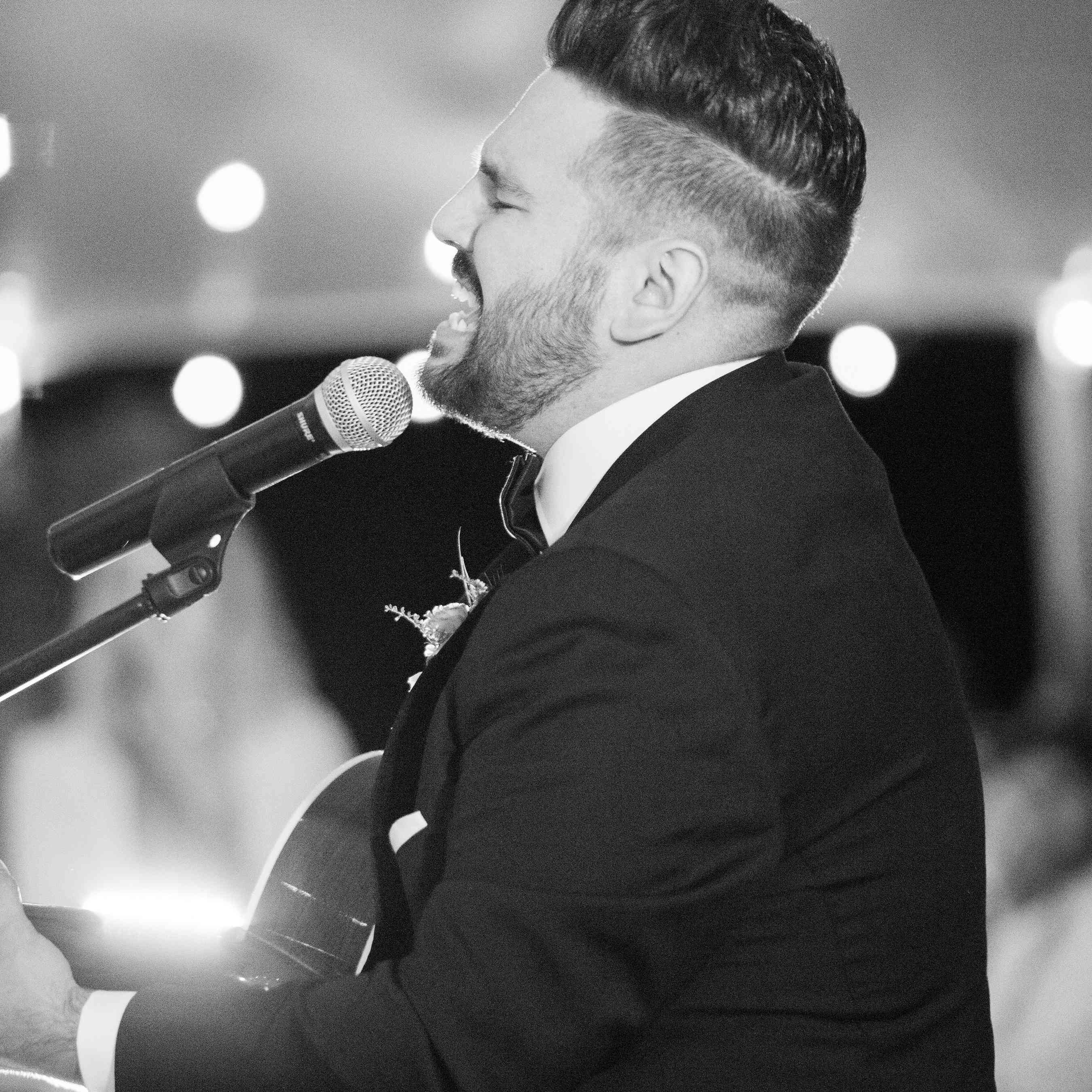 <p>Groom singing at wedding</p><br><br>