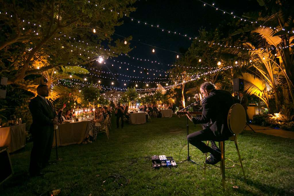Father playing guitar at daughter's wedding