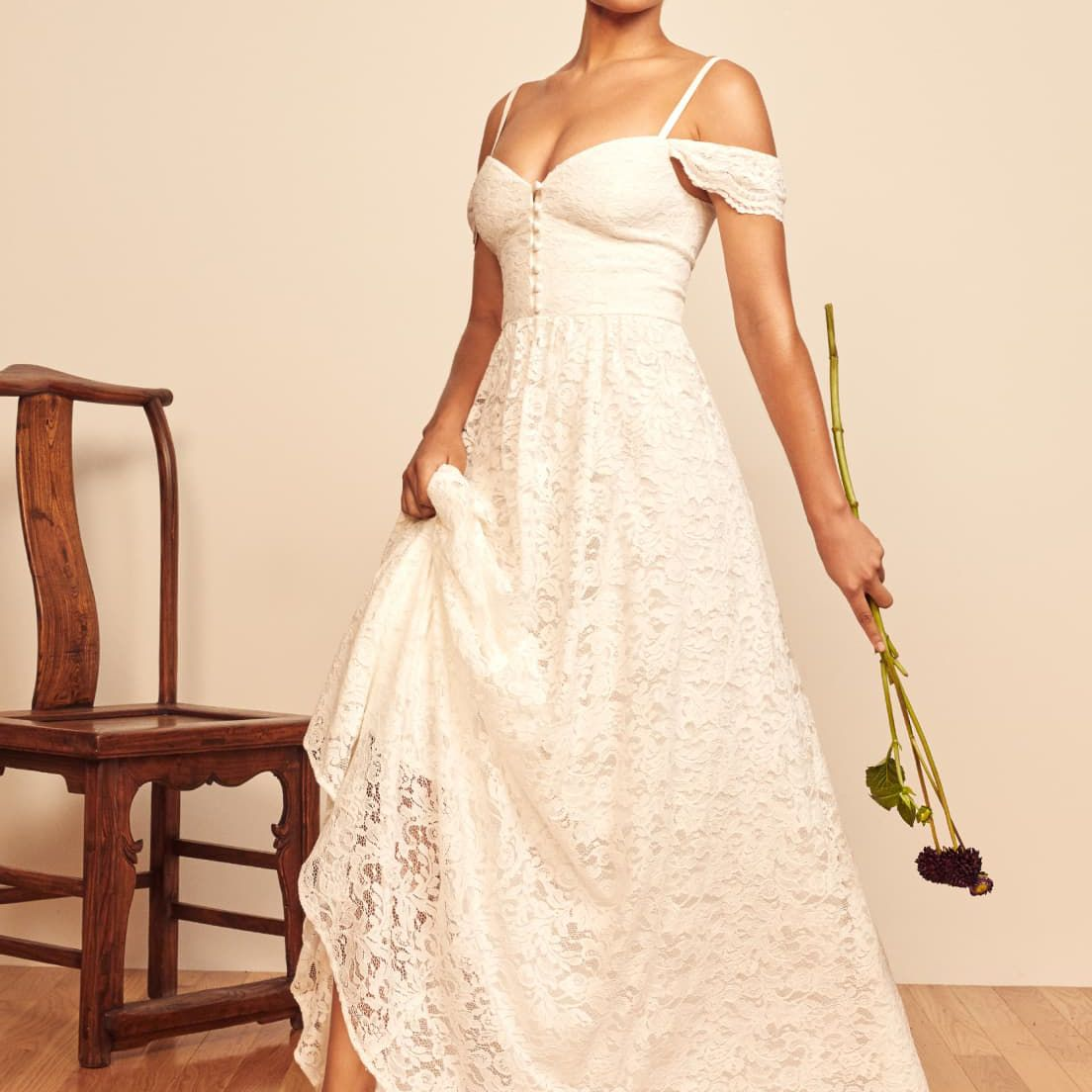 Model in off-the-shoulder all-over lace white gown