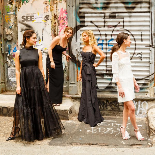 <p>bridesmaids in mismatched black evening gowns</p>