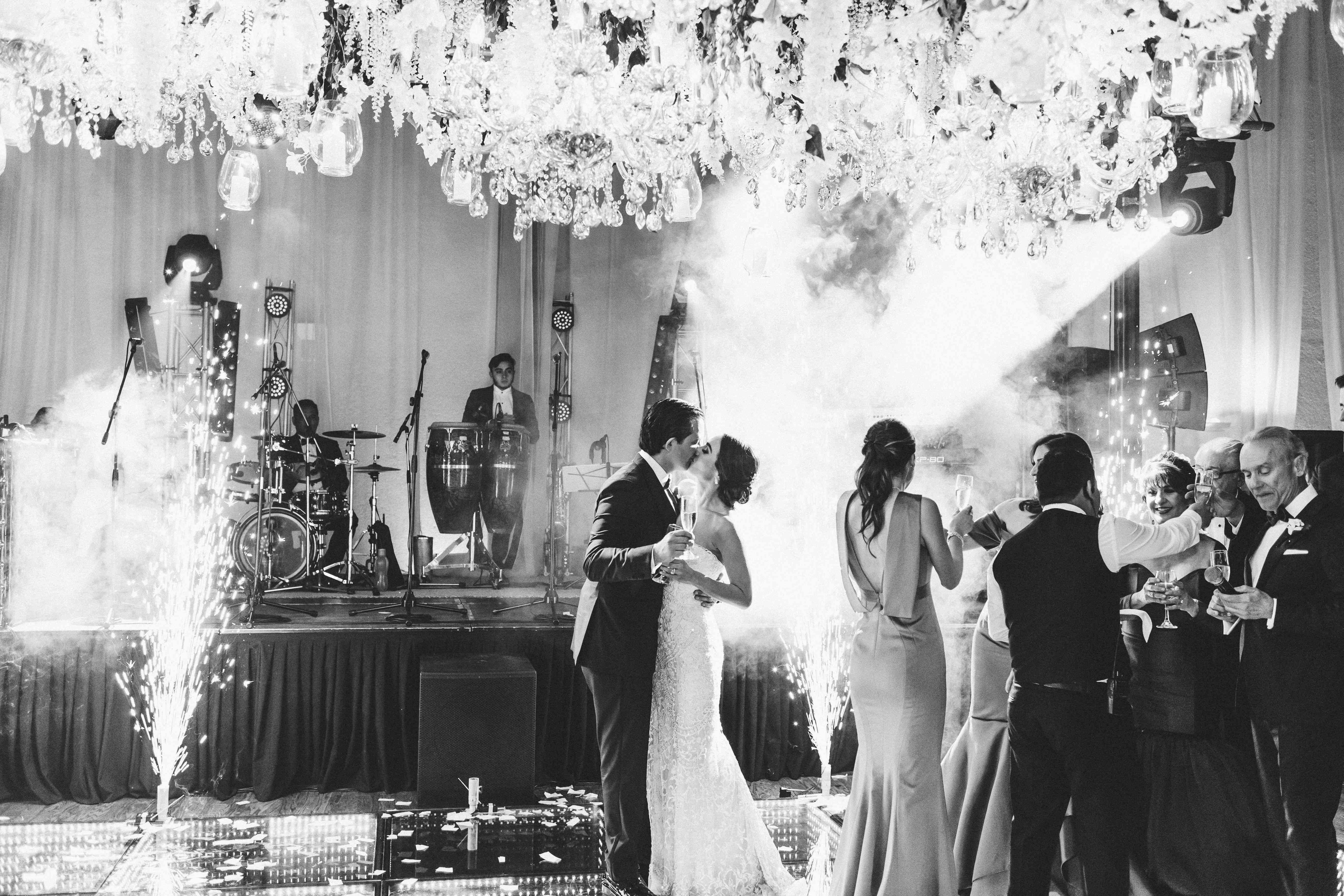 <p>dance floor sparklers bride and groom kissing</p><br><br>