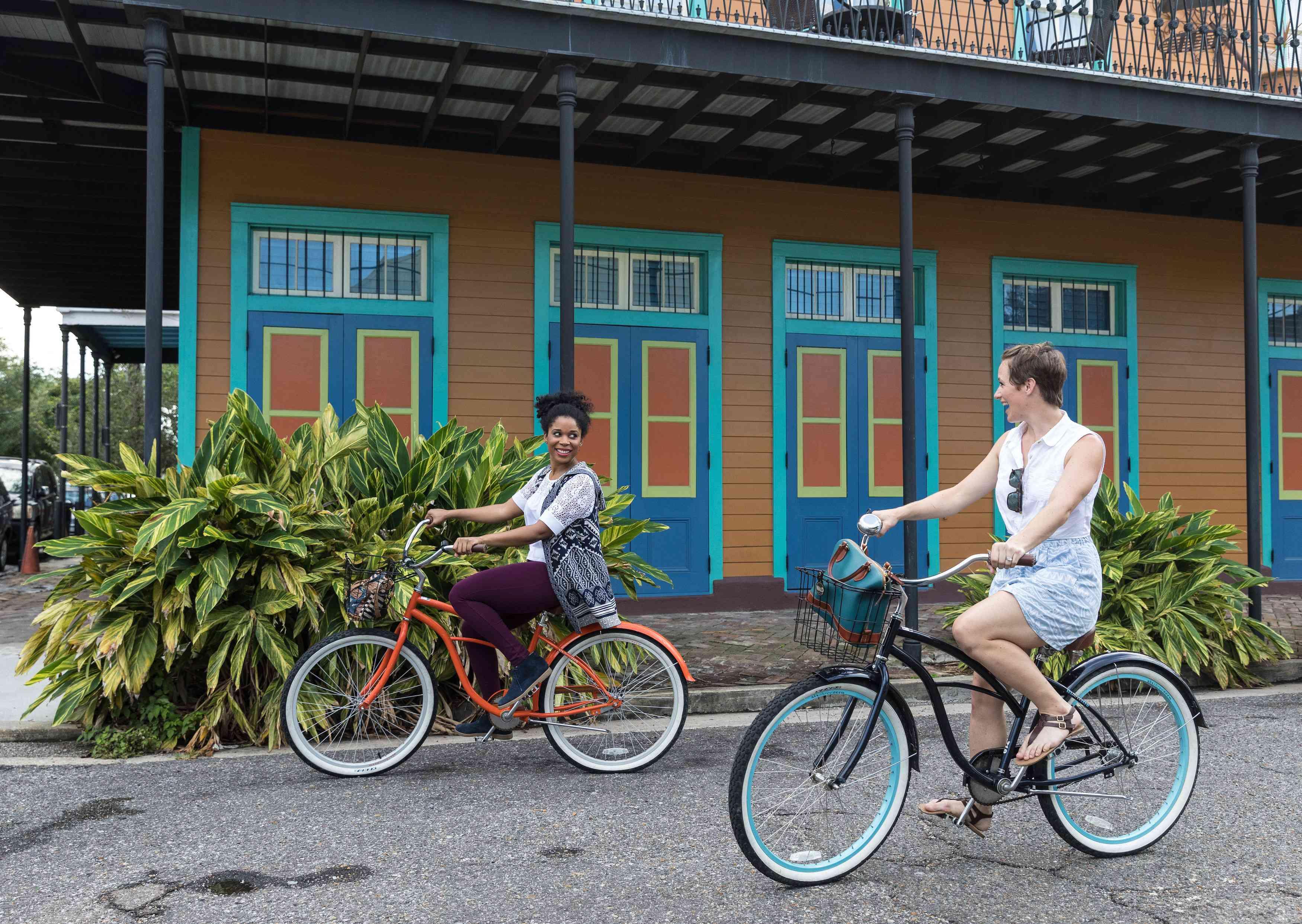 An LGBTQ couple biking through New Orleans