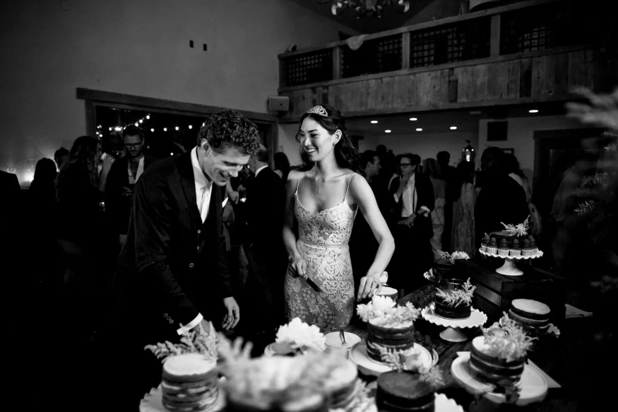 Newlyweds cutting multiple cakes