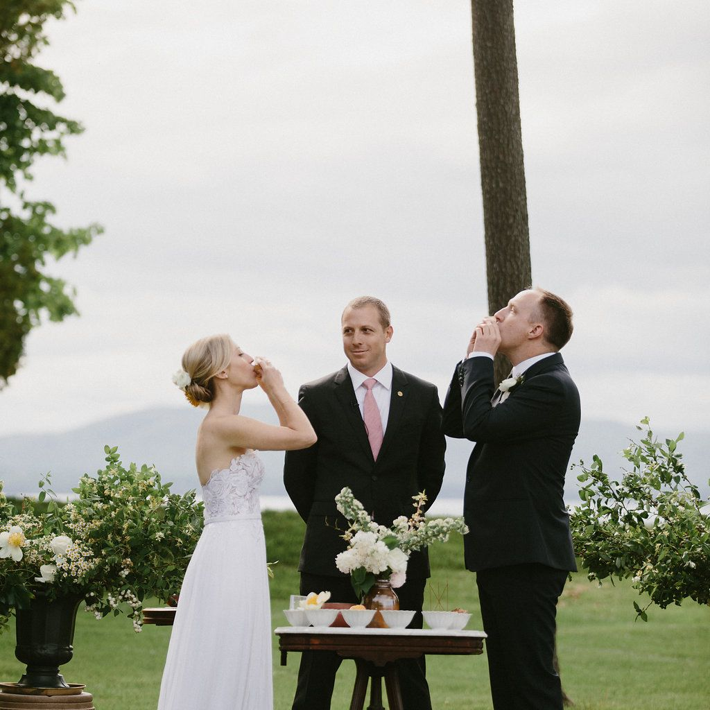 Bride and groom drinking at ceremony