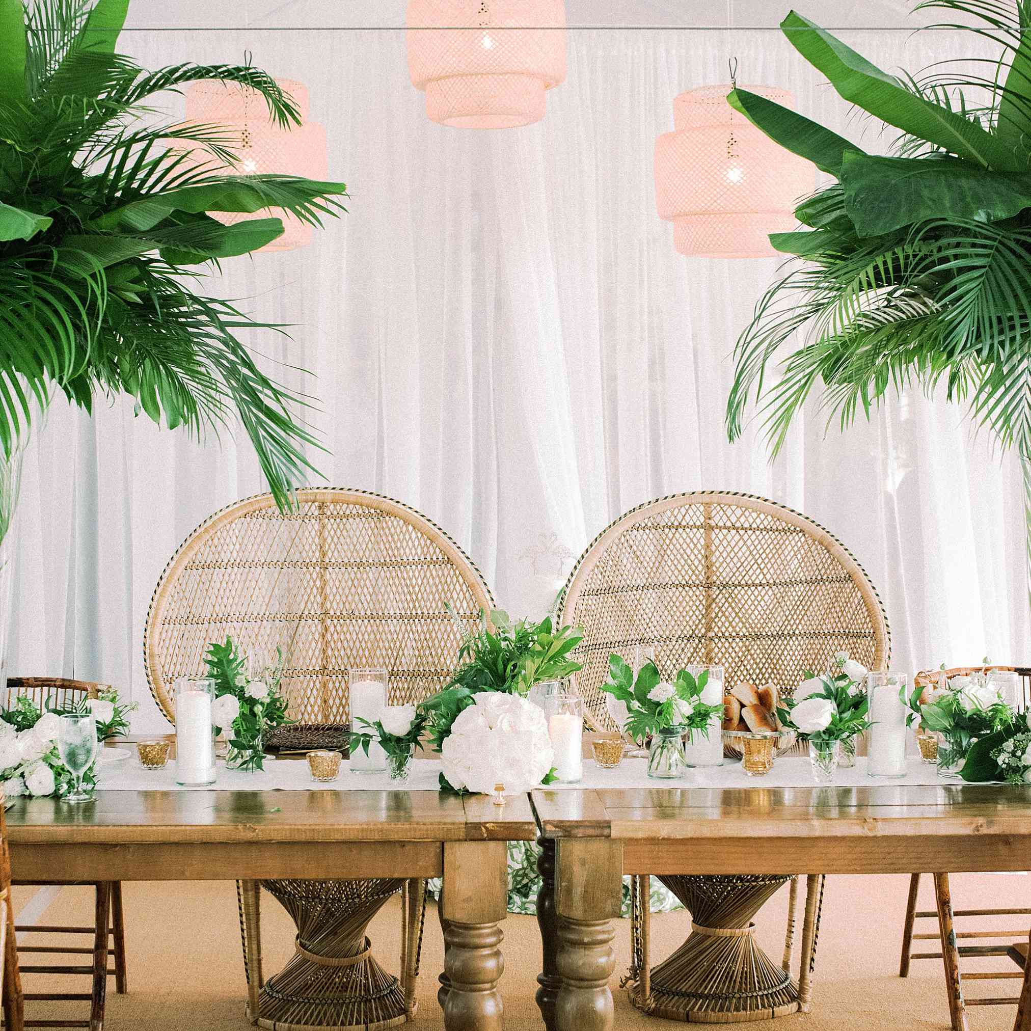 Table with statement rattan chairs and palm accents