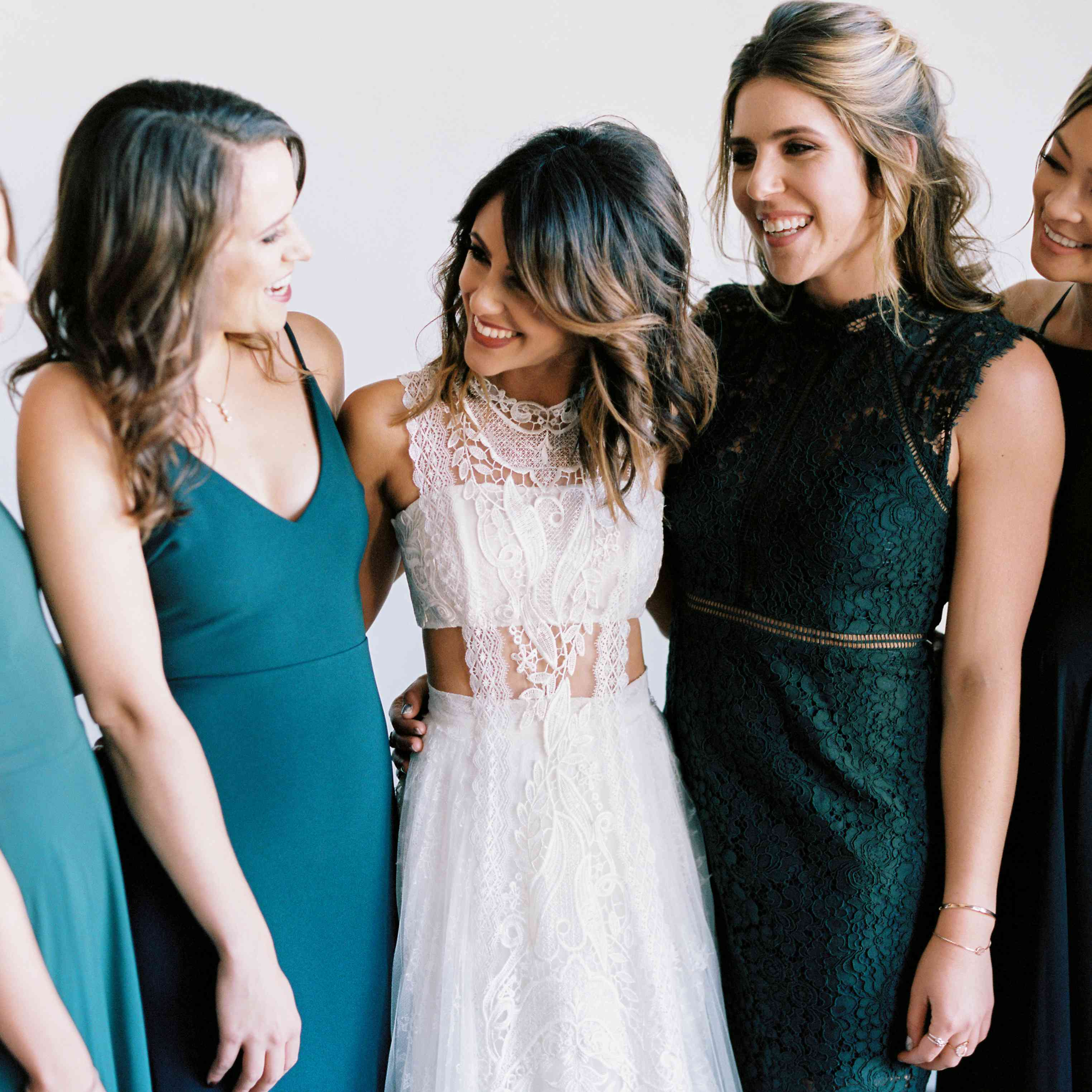 bridesmaids in mismatched emerald green dresses