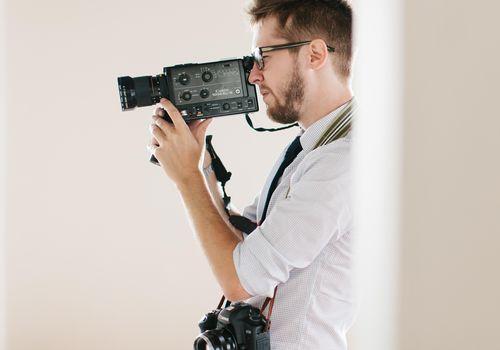 A videographer shooting an event
