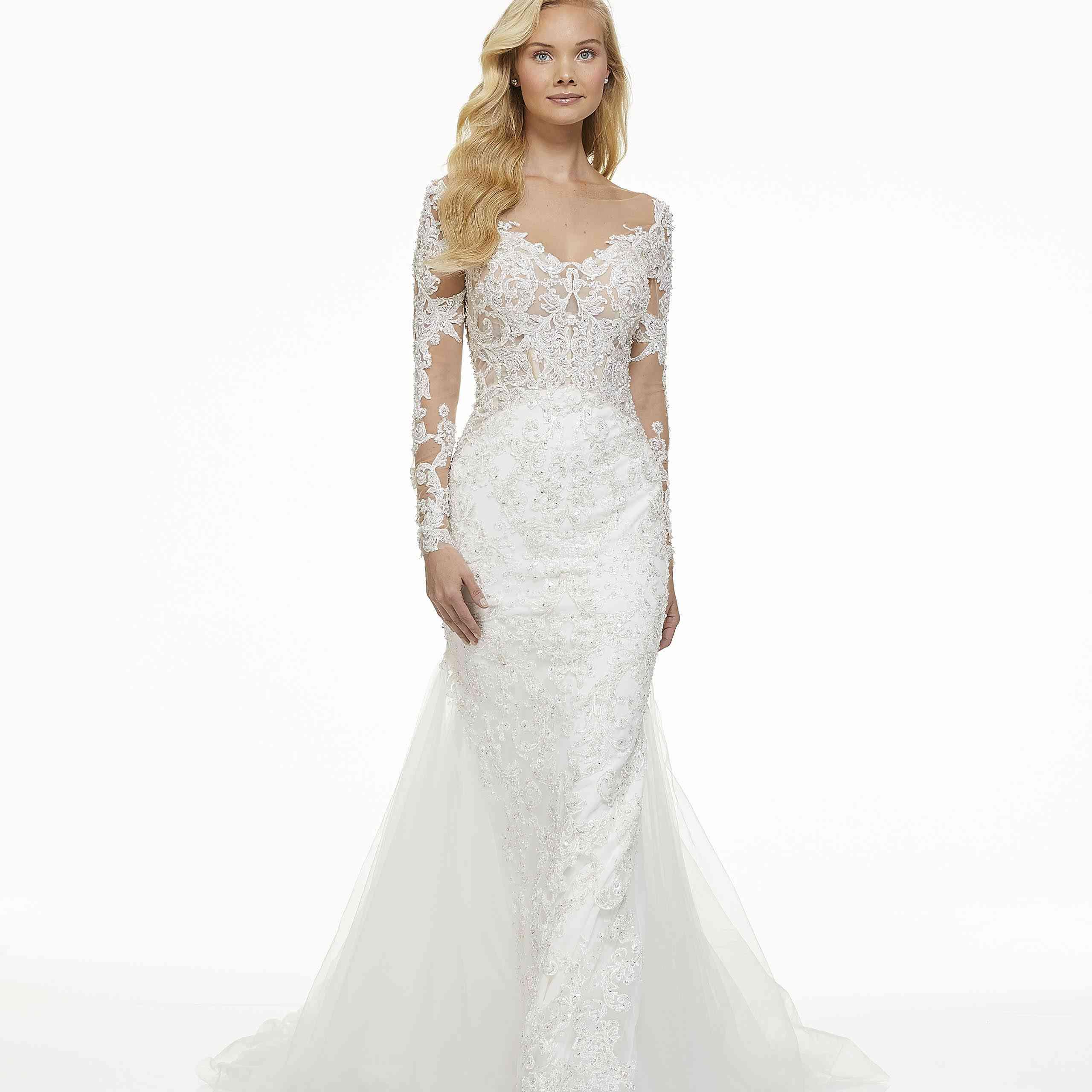 Model in long sleeve lace wedding dress