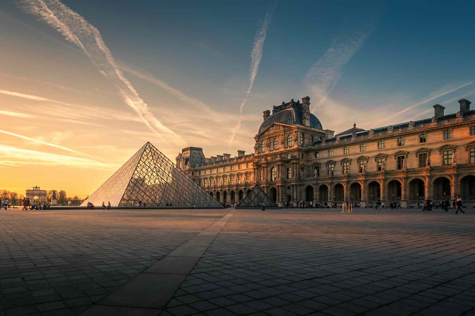 Sunset view of the Louvre and pyramid
